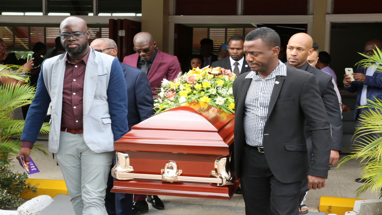 Pallbearers carry the casket bearing the remains of Raymond Peart, more popularly known as DJ Venom, outside the Boulevard Baptist Church in St Andrew on Saturday.