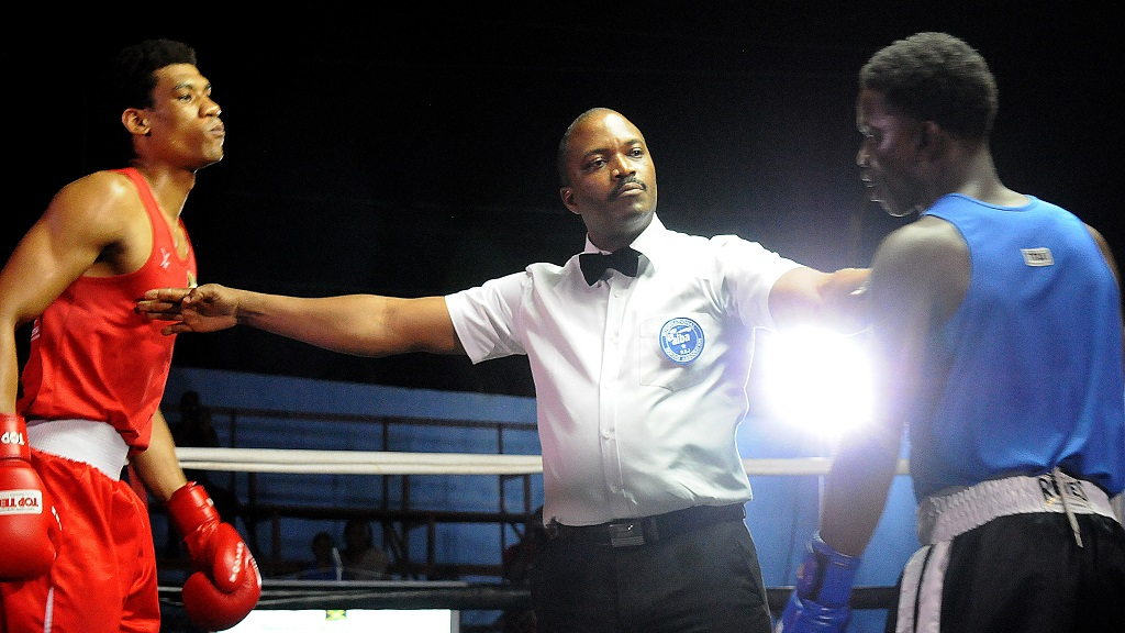 Referee Kevin Stupart  (centre) separates Josua Frazer (left) and Jameer Edwards during their welterweight bout at last weekend's  National Boxing Championships at the Stanley Couch Gym.  Frazer was disqualified midway the second round.