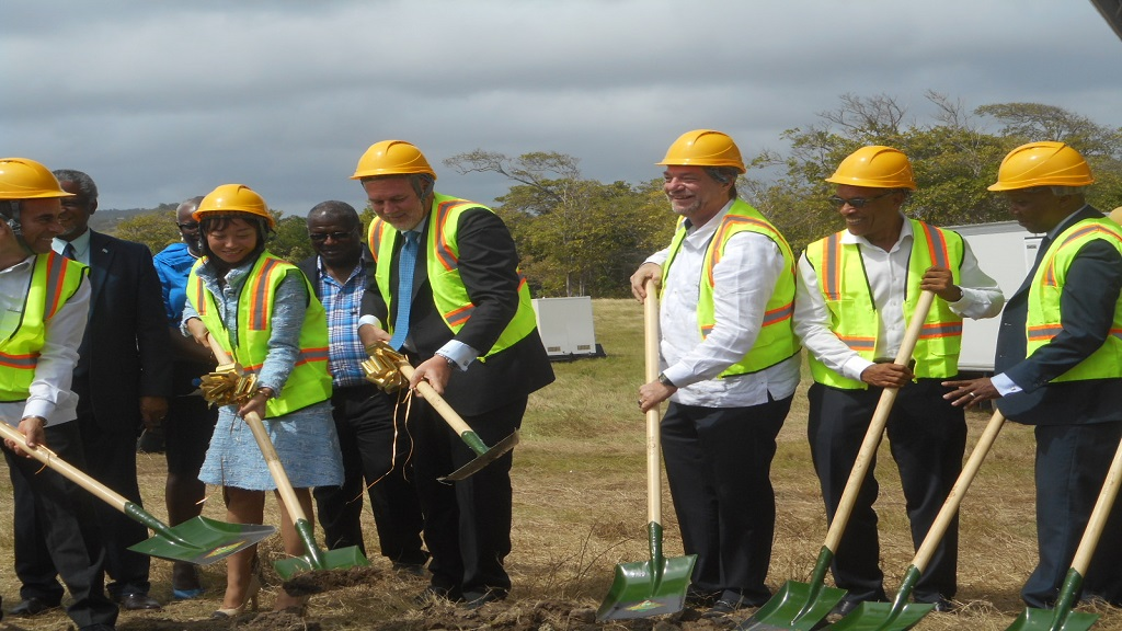 Prime Minister Allen Chastanet flanked by officials of Canelles Resort and Invest St Lucia turning the sod.