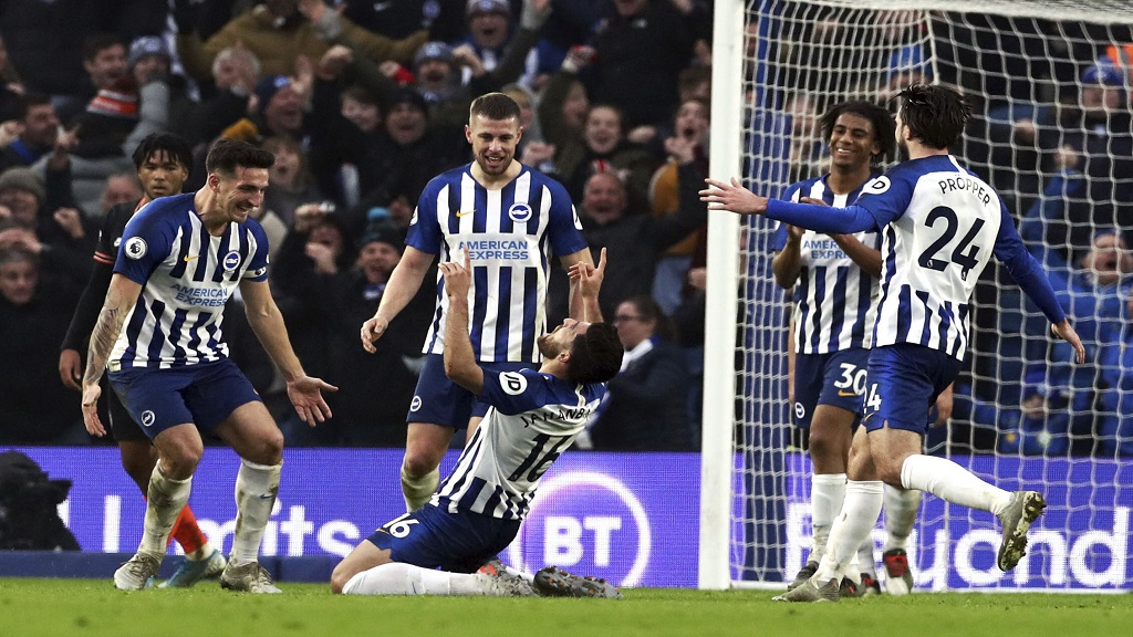 Brighton's Alireza Jahanbakhsh, centre, celebrates scoring the equalising goal against Chelsea during their English Premier League football at the AMEX Stadium, Brighton, England, Wednesday Jan. 1, 2020. (Gareth Fuller/PA via AP).