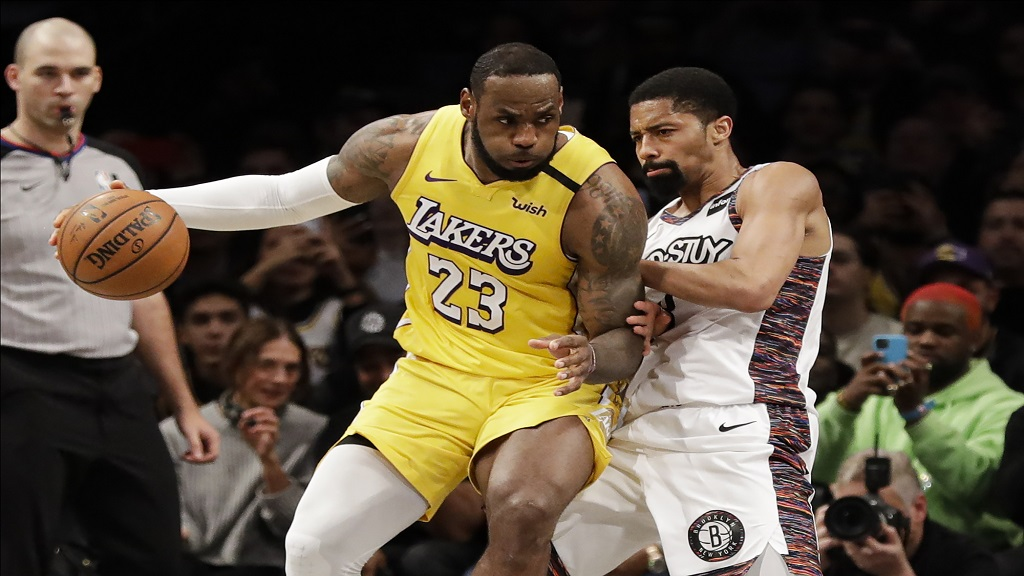 Brooklyn Nets' Spencer Dinwiddie defends Los Angeles Lakers' LeBron James (23) during the second half of an NBA basketball game Thursday, Jan. 23, 2020, in New York. The Lakers won 128-113. (AP Photo/Frank Franklin II).