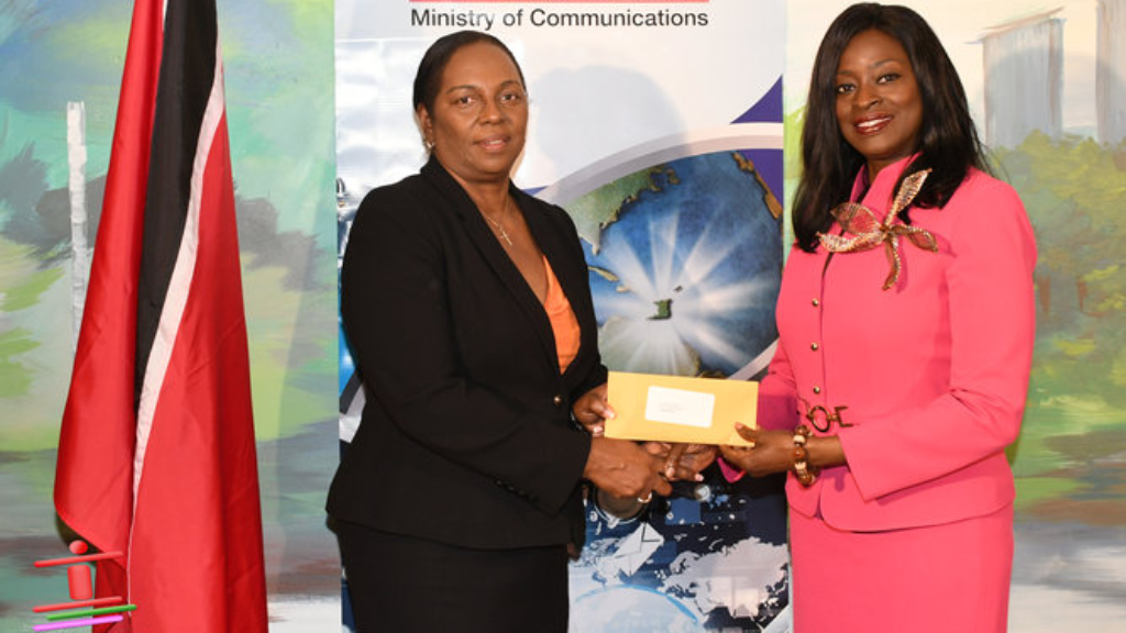 Pictured: New TTT Chairperson, Ronda Francis (left), receives her instruments of appointment from Minister of Communications, Donna Cox (right). Photo courtesy The Ministry of Communications.