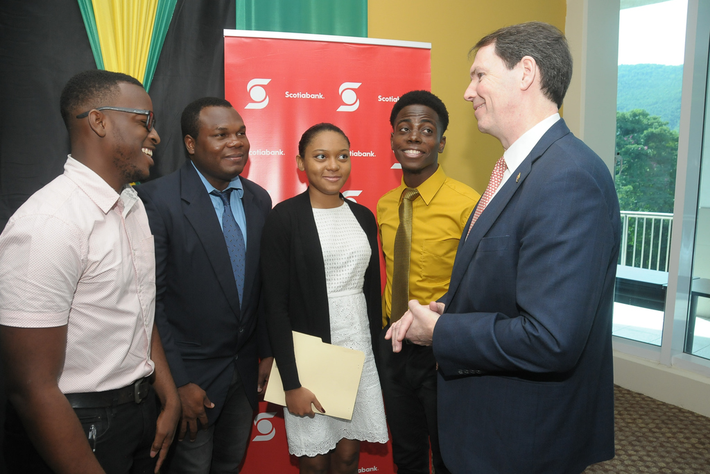 Brendan King, Scotiabank's Senior Vice President of International Banking  with Scotiabank scholarship recipients at The UWI Mona Campus.