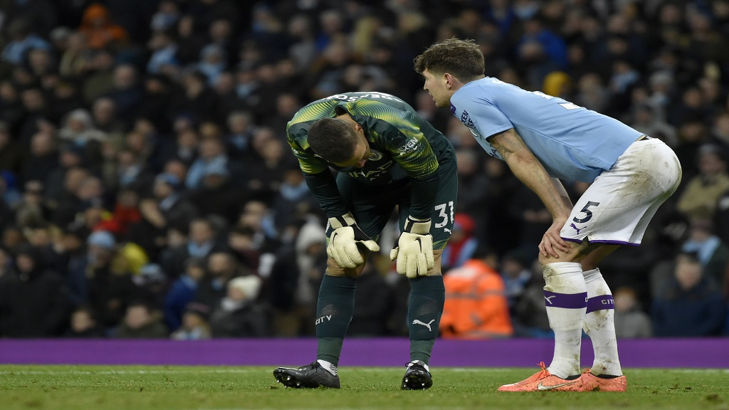 Manchester City's goalkeeper Ederson, left, and John Stones react after Fernandinho scores an own goal during the English Premier League football match against Crystal Palace at Etihad stadium in Manchester, England, Saturday, Jan. 18, 2020. (AP Photo/Rui Vieira).