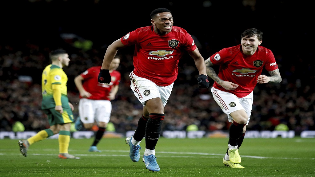 Manchester United's Anthony Martial celebrates scoring during the English Premier League football match against Norwich City at Old Trafford, Manchester, England, Saturday Jan. 11, 2020. (Martin Rickett/PA via AP).