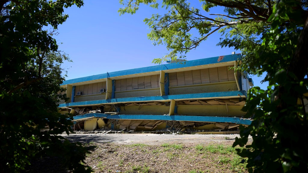 The Adripina Seda public school stands partially collapsed after an earthquake struck Guanica, Puerto Rico, Tuesday, Jan. 7, 2020. (AP Photo/Carlos Giusti)