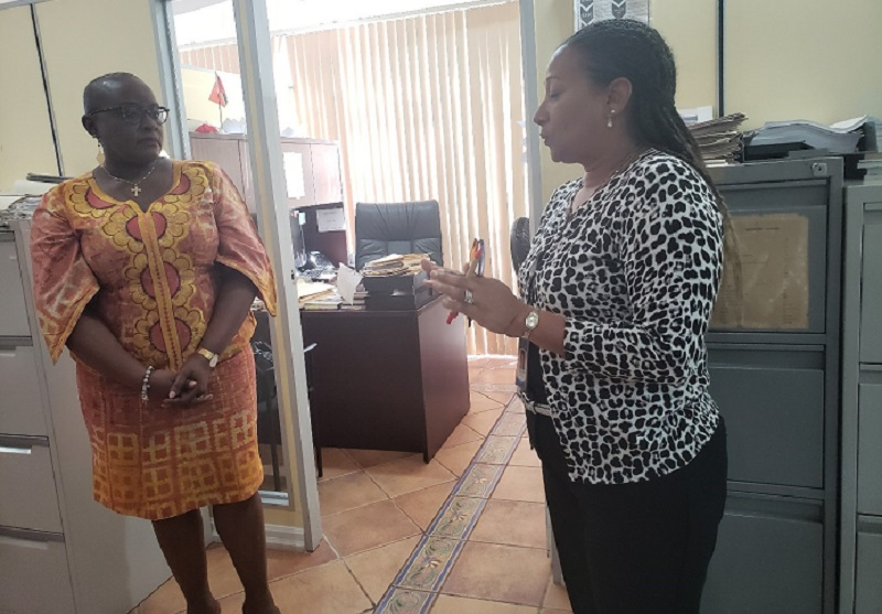 Director of the Social Displacement Unit (SDU) of the Ministry Loraine Reyes-Borel (right) shares details of the homeless man's relocation with Minister Camille Robinson-Regis (left)