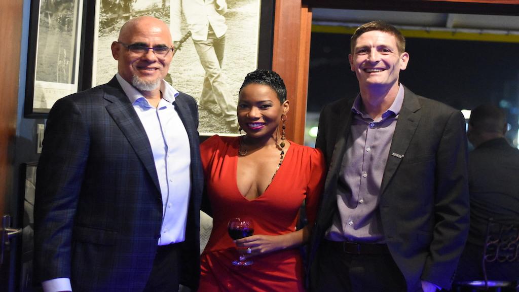 PSOJ President and CEO Keith Duncan (left) and Mackeba Bennett-Easy shares the spotlight with Trend Media Group Director Declan Tully. (Photos: Marlon Reid)