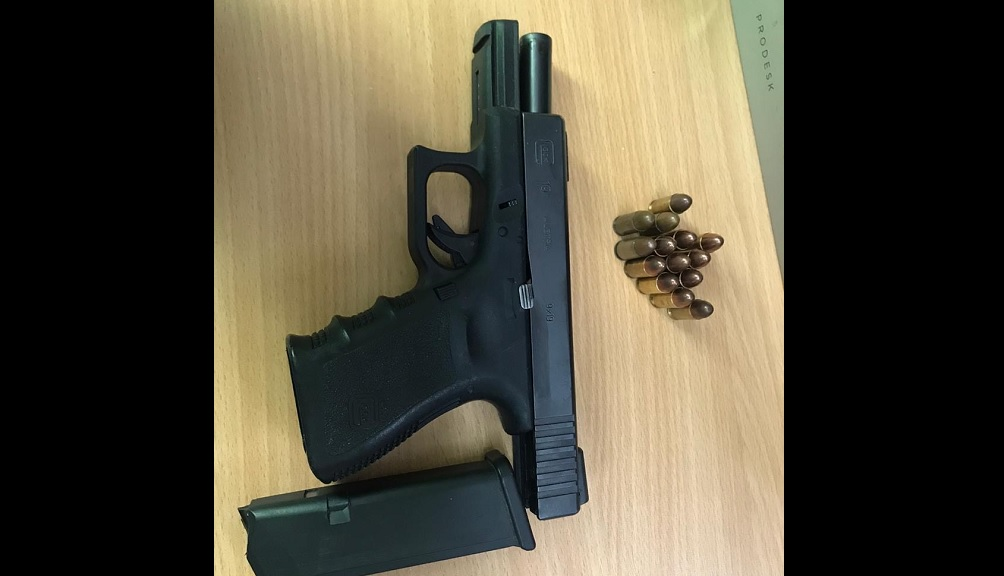 A photo of the gun and ammunition allegedly found in the possession of taxi operator Paul Pryce on Friday.