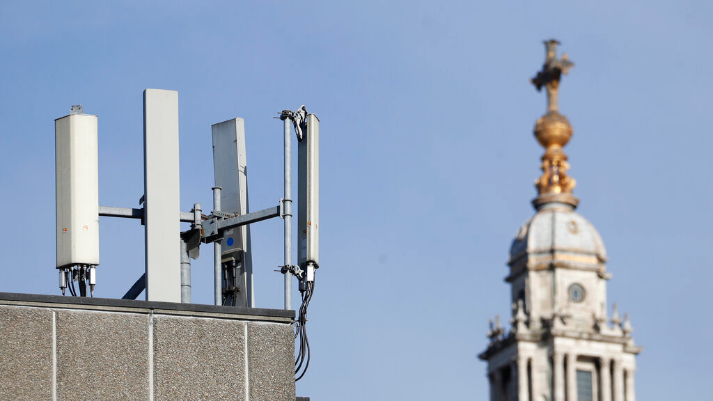 Mobile network phone masts are visible in front of St Paul's Cathedral in the City of London, Tuesday, January 28, 2020. (AP Photo/Alastair Grant)