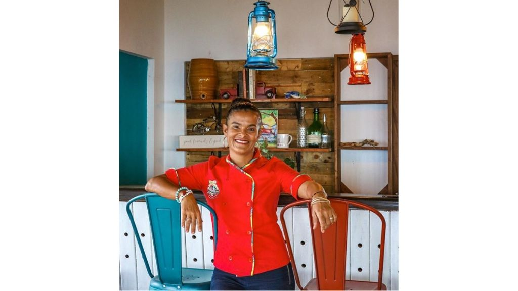 Miss T's Kitchen principal Anna-Kay Tomlinson at the Main Street, Ocho Rios eatery. (Photos via Instagram/@misstskitchen & via usatoday.com)