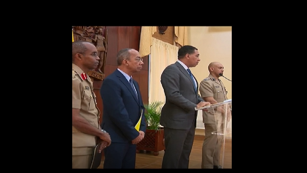 Left to right, the chief of defence staff, national security minister, prime minister and police commissioner at Sunday's press conference at Jamaica House, where the latest state of emergency declaration was made.