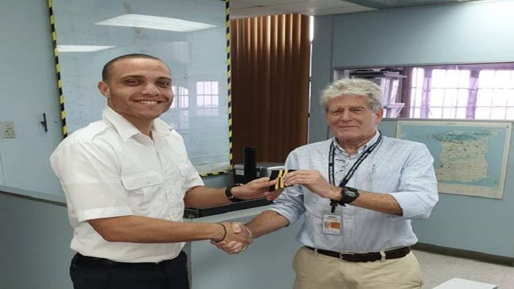 Captain Nicholas Nothnagel, of the National Helicopters in Trinidad, presenting Darren with his First Officer bars.