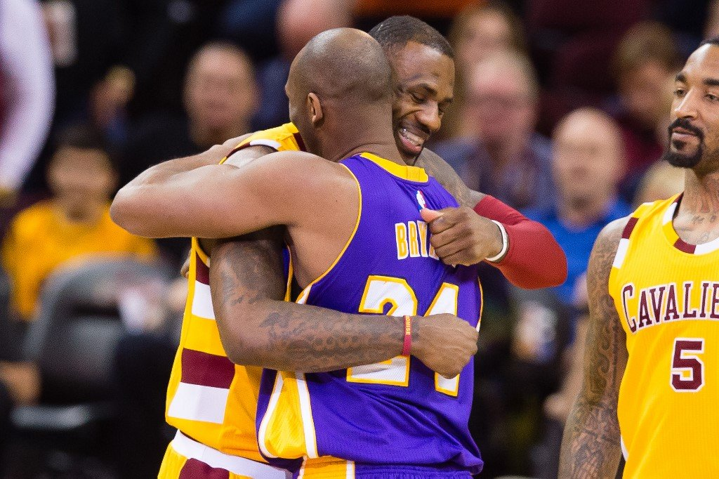 LeBron James greets Kobe Bryant during the first half at Quicken Loans Arena on February 10, 2016 in Cleveland, Ohio. Jason Miller/Getty Images/AFP
