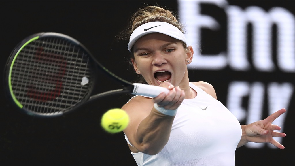 Romania's Simona Halep makes a forehand return to Britain's Harriet Dart during their second round singles match at the Australian Open tennis championship in Melbourne, Australia, Thursday, Jan. 23, 2020. (AP Photo/Dita Alangkara).