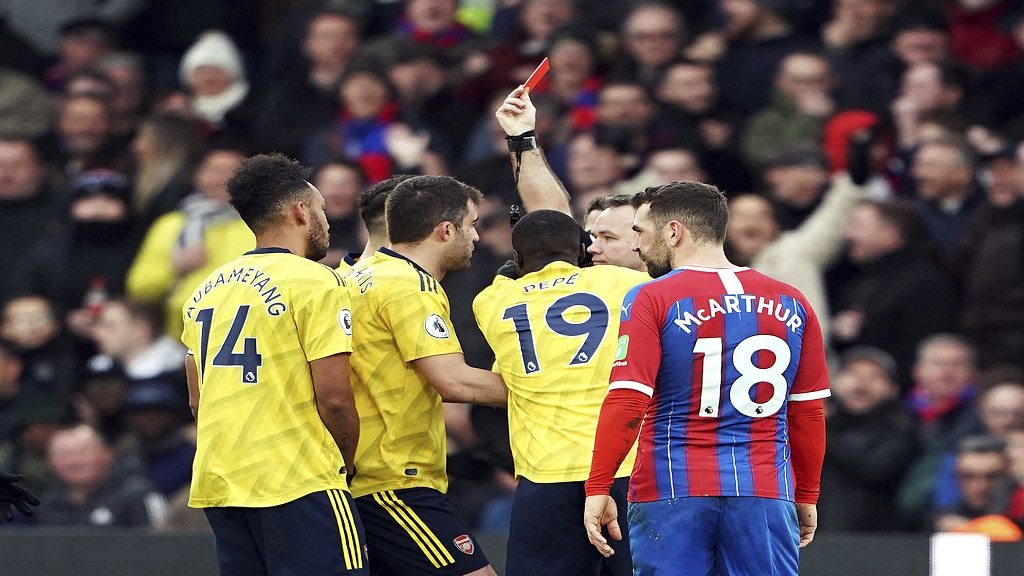 Referee Paul Tierney shows Pierre-Emerick Aubameyang, left, a red card following a VAR review , during the English Premier League football match between Crystal Palace and Arsenal, at Selhurst Park, in London, Saturday, Jan. 11, 2020. (Tess Derry/PA via AP).