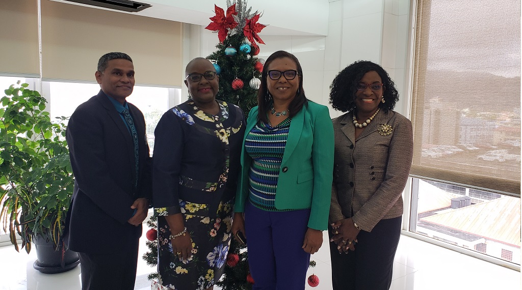 Newly appointed Minister of Social Development and Family Services Camille Robinson-Regis (second from left); Permanent Secretary Jacinta Bailey-Sobers (2nd from right); Deputy Permanent Secretaries Vijay Gangapersad (left) and June Belle (right).