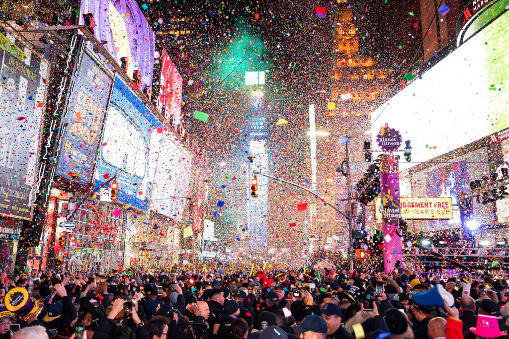 Confetti falls at midnight on the Times Square New Year's Eve celebration, January 1, 2020, in New York. (Photo by Ben Hider/Invision/AP)