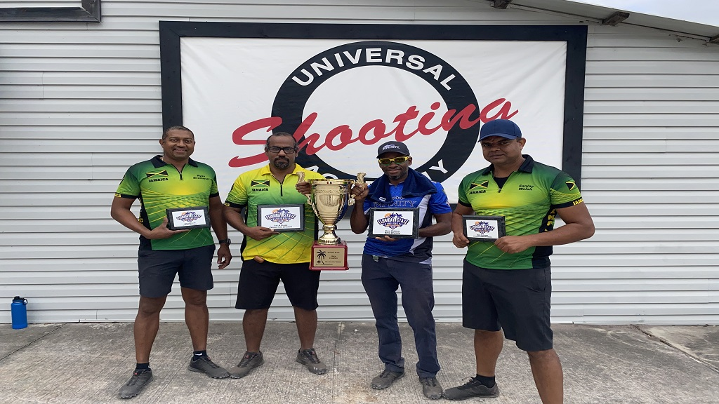 Jamaican pistol shooters show off their awards at the end of  the recent Florida State United States Practical Shooting Association (USPSA) Championships.  Team members are (from left) Ryan Bramwell, Darin Richards, Lesgar Murdock and Sanjay Welsh.