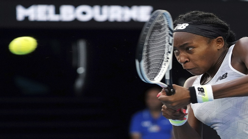 Coco Gauff of the U.S. makes a backhand return to Japan's Naomi Osaka during their third round singles match at the Australian Open tennis championship in Melbourne, Australia, Friday, Jan. 24, 2020. (AP Photo/Lee Jin-man).