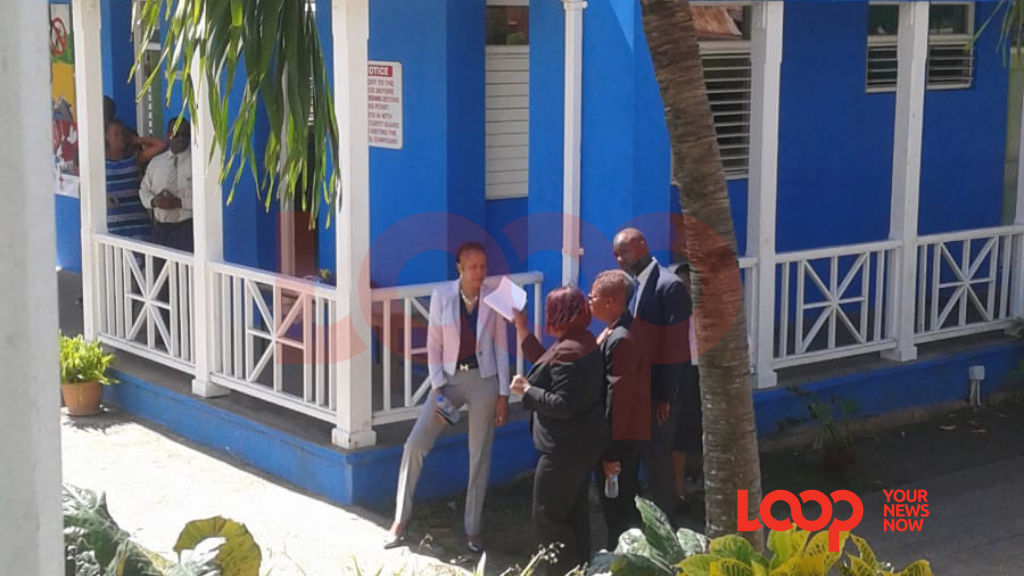 (left) Minister of Education Santia Bradshaw speaking with St Alban's principal and other officials.