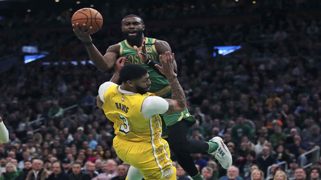 Boston Celtics guard Jaylen Brown drives to the basket against Los Angeles Lakers forward Anthony Davis (3) during the first half of an NBA basketball game in Boston, Monday, Jan. 20, 2020. (AP Photo/Charles Krupa).