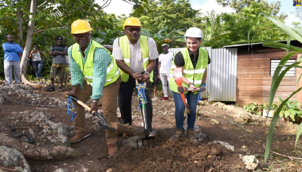 Minister of Local Government and Community Development, Desmond McKenzie (left), is joined by Mayor of Port Antonio, Councillor Paul Thompson; and Member of Parliament for Eastern Portland, Ann-Marie Vaz, in breaking ground for the construction of a house for a needy family in Long Road, Portland, on Tuesday, January 7.