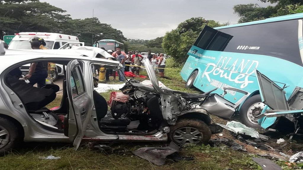The scene of the crash on the Hague main road in Trelawny last Sunday morning which resulted in the deaths of four men and serious injury to a Canadian woman who was visiting the island.