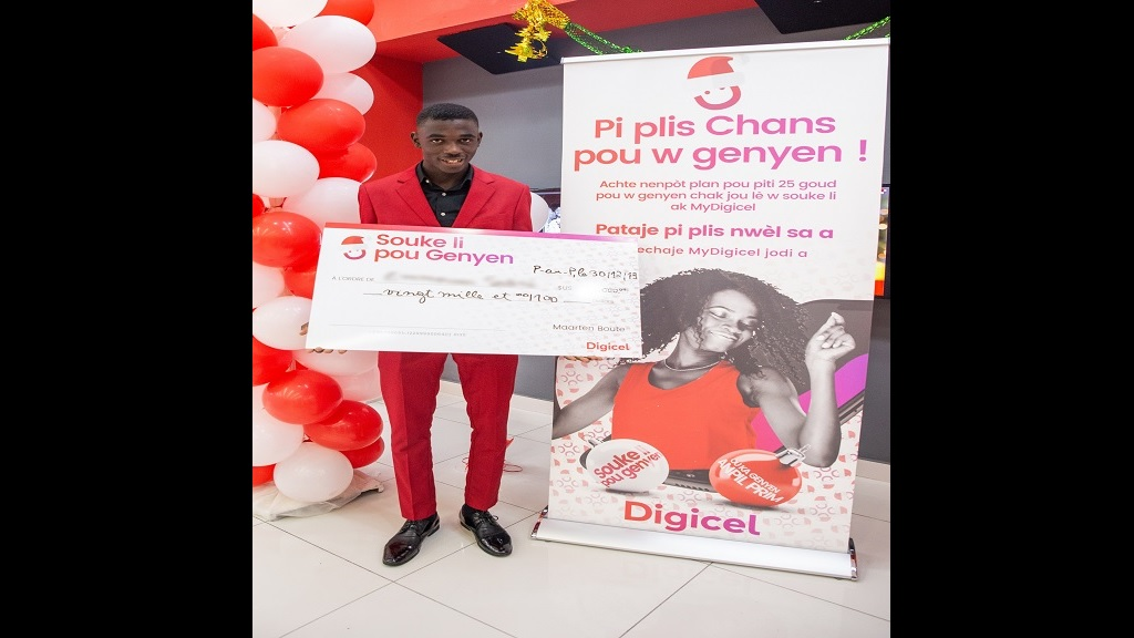 Emerson, 18 yo amateur football player from Haiti, is the winner of Digicel's 'Shake to Win' Christmas promotion regional grand prize.