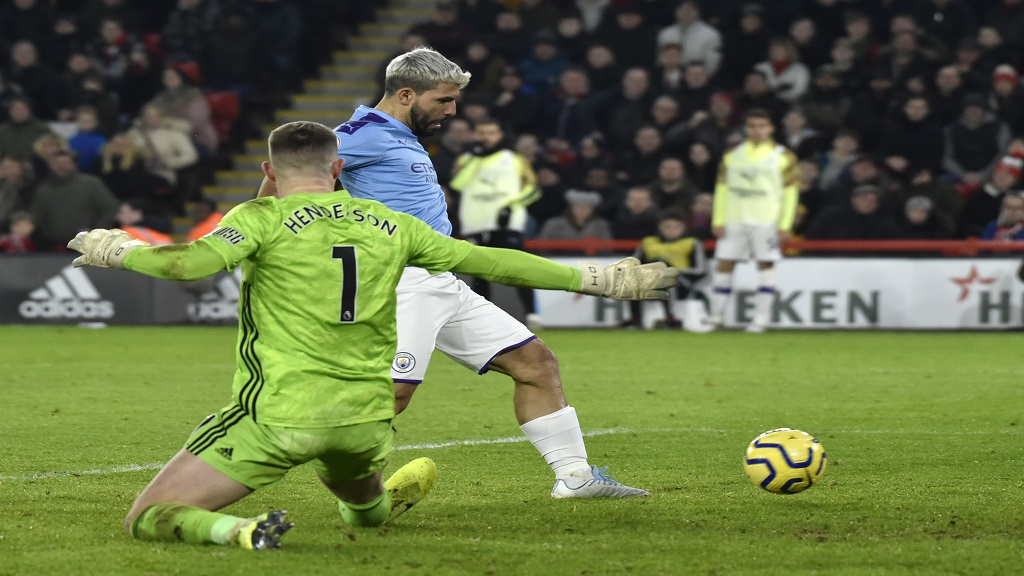 Manchester City's Sergio Aguero scores during the English Premier League football match against Sheffield United at Bramall Lane in Sheffield, England, Tuesday, Jan. 21, 2020. (AP Photo/Rui Vieira).