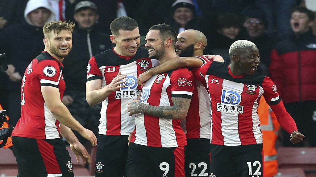 Southampton's Danny Ings, centre, celebrates with teammates after scoring against Tottenham in their English Premier League football match at St Mary's Stadium, in Southampton, England, Wednesday Jan. 1, 2020. (Mark Kerton/PA via AP).