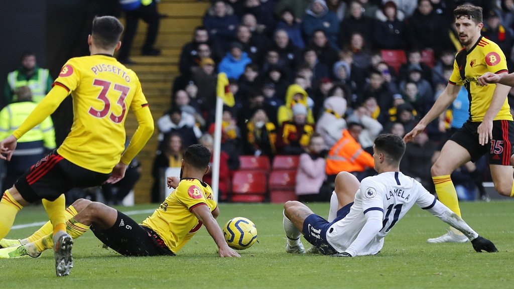 Tottenham's Erik Lamela, right, makes an attempt to score during the English Premier League football match against  Watford at Vicarage Road, Watford, England, Saturday, Jan. 18, 2020. (AP Photo/Frank Augstein).