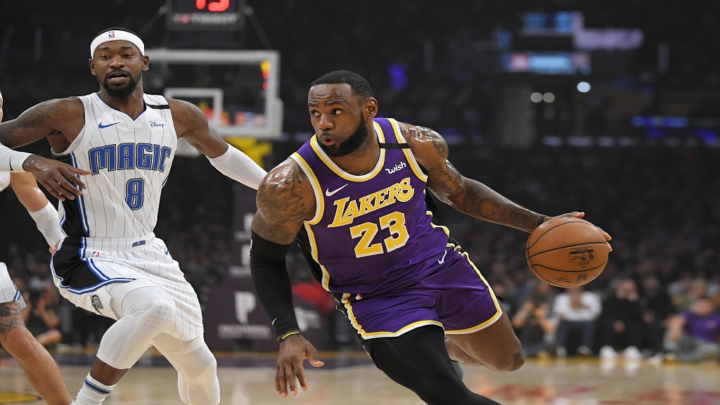 Los Angeles Lakers forward LeBron James, right, drives toward the basket as Orlando Magic guard Terrence Ross defends during the first half of an NBA basketball game Wednesday, Jan. 15, 2020, in Los Angeles. (AP Photo/Mark J. Terrill).