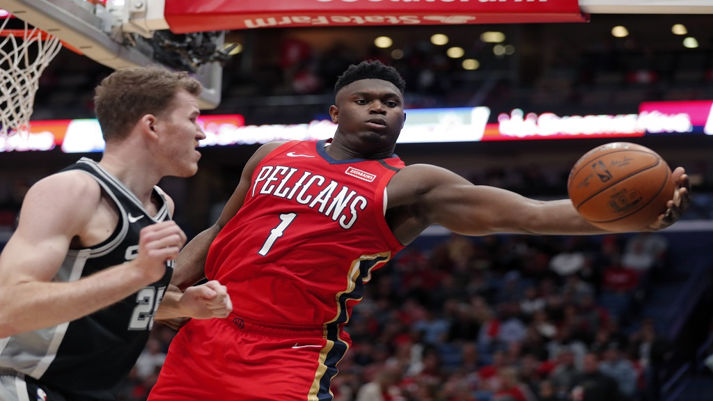 New Orleans Pelicans forward Zion Williamson (1) pulls in a rebound against San Antonio Spurs center Jakob Poeltl (25) in the second half of an NBA basketball game in New Orleans, Wednesday, Jan. 22, 2020. The Spurs won 121-117. (AP Photo/Gerald Herbert).