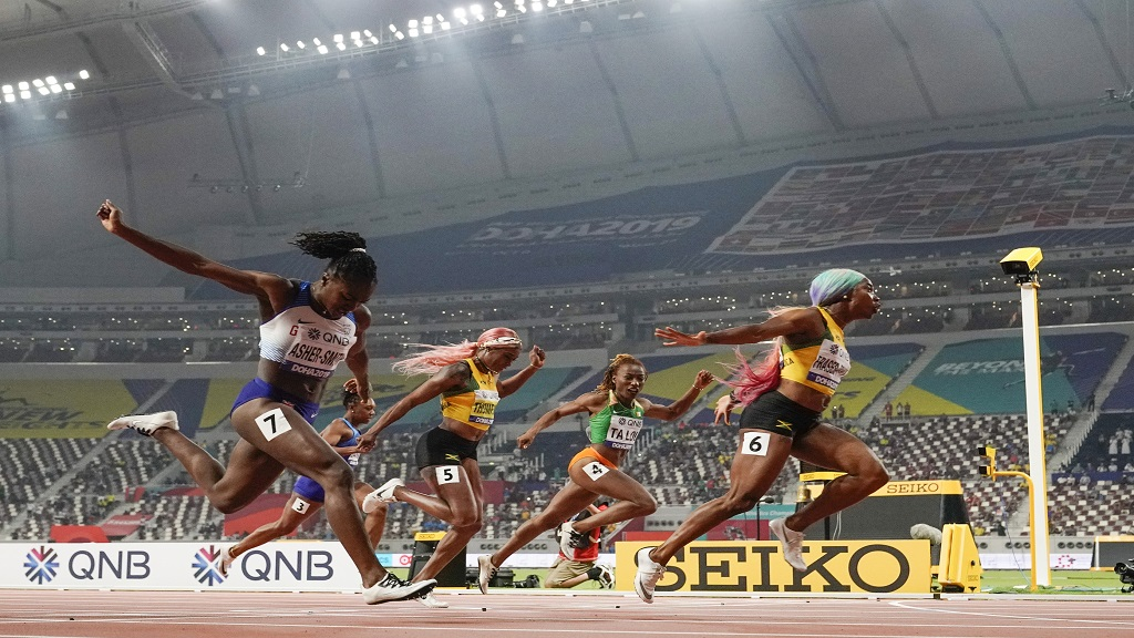 Shelly-Ann Fraser-Pryce (6), of Jamaica, finishes ahead of Dina Asher-Smith (7), of Britain, and Marie-Josée Ta Lou (4), of The Ivory Coast, in the women's 100-metre final at the World Athletics Championships in Doha, Qatar, Sept. 29, 2019. (AP Photo/David J. Phillip).
