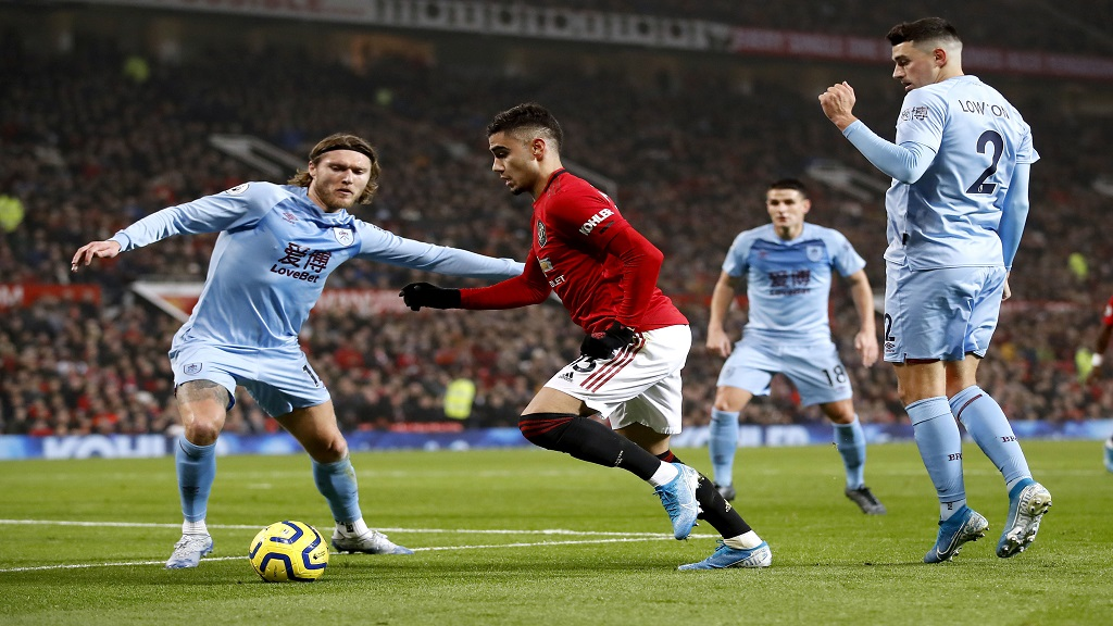 Burnley's Jeff Hendrick, left and Manchester United's Andreas Pereira battle for the ball during their English Premier League football match at Old Trafford, in Manchester, England, Wednesday, Jan. 22, 2020. (Martin Rickett/PA via AP).