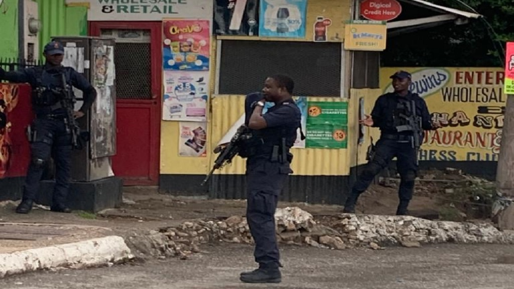 File photo of a heavily armed police team on patrol on Mountain View Avenue in Kingston recently.