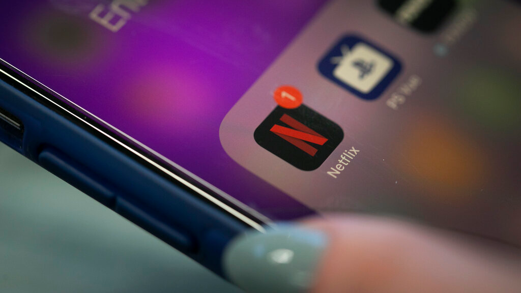 FILE - This Oct. 8, 2019, file photo shows the Netflix app on an iPhone in New York. Netflix reports financial results Tuesday, January 21, 2020. (AP Photo/Jenny Kane, File)