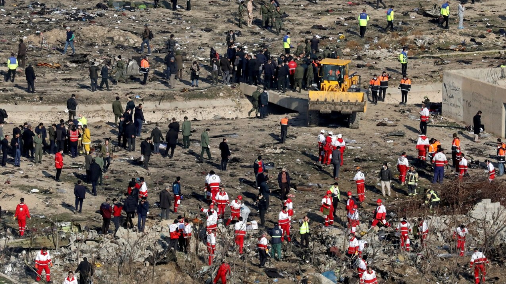 In this Wednesday, Jan. 8, 2020, photo, rescue workers search the scene where a Ukrainian plane crashed in Shahedshahr, southwest of the capital Tehran, Iran. (AP Photo/Ebrahim Noroozi).