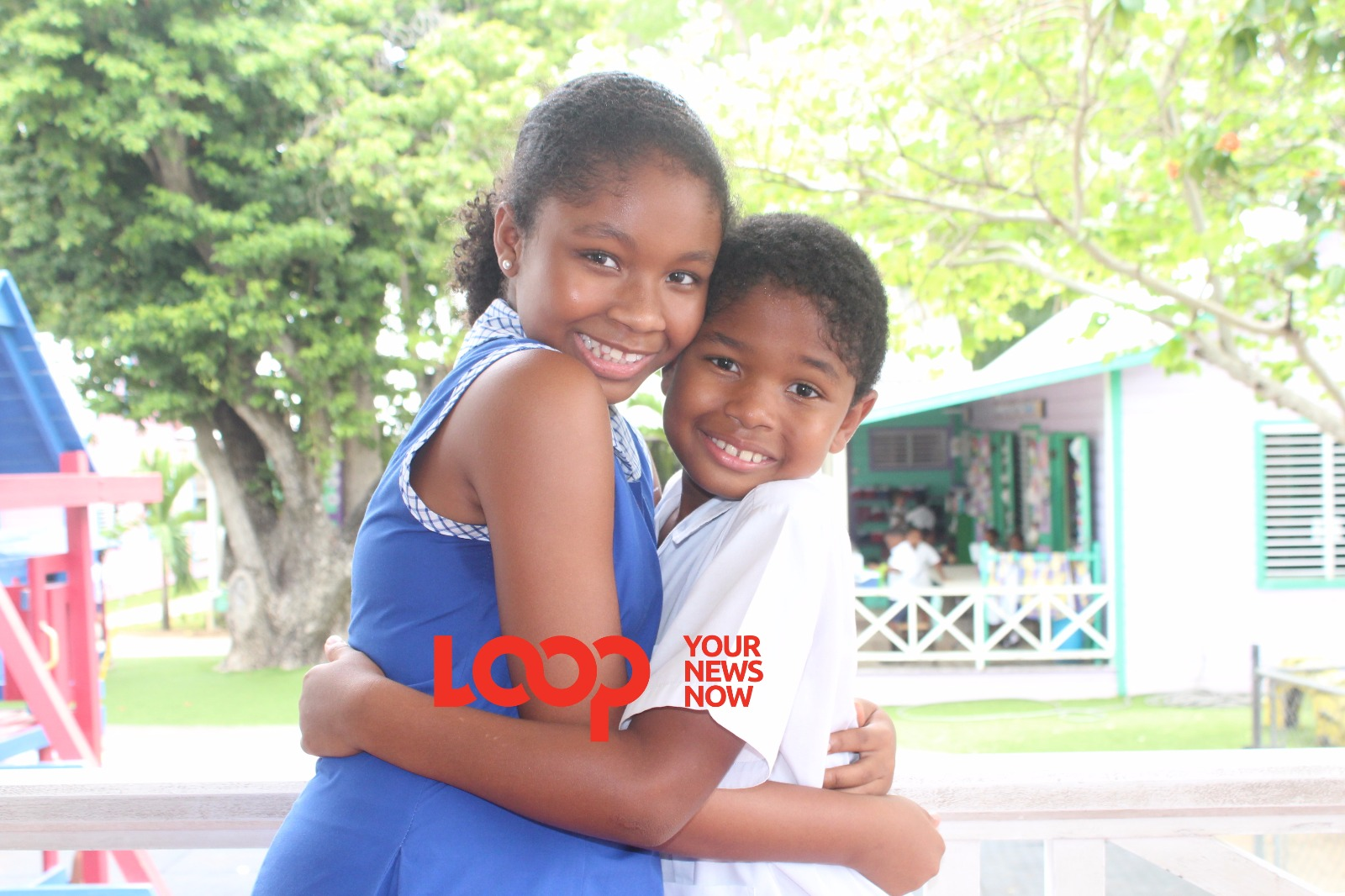 Top Girl in the island in the 2019 Barbados Secondary Schools' Entrance Examination hugging her little brother.