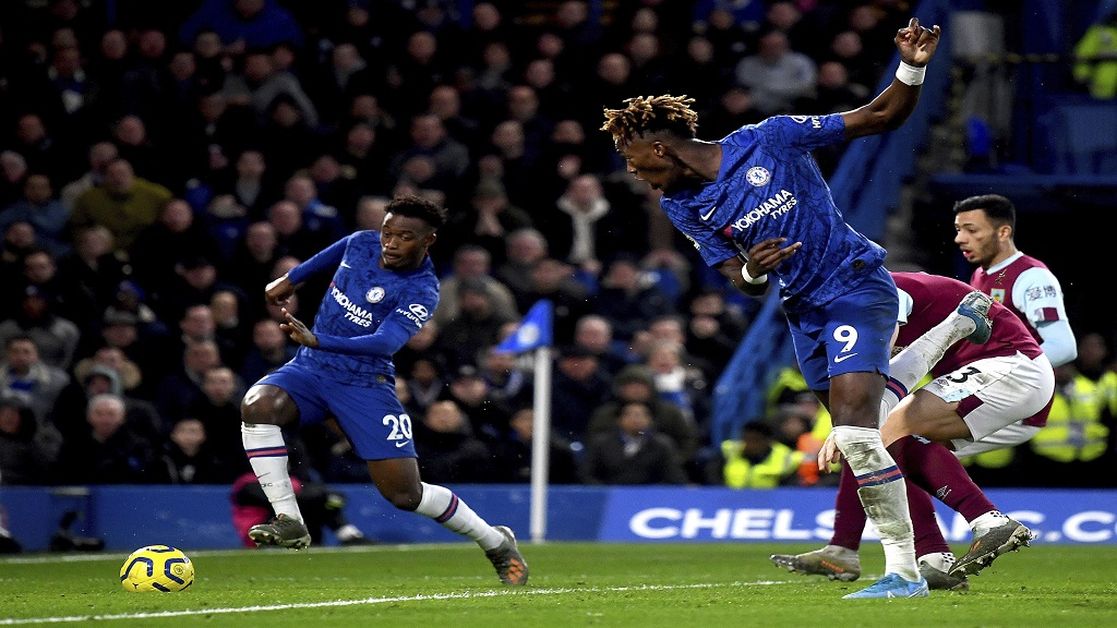 Chelsea's Callum Hudson-Odoi, left, on his way to score his team's third goal, during the English Premier League football match against Burnley at Stamford Bridge, in London, Saturday, Jan. 11, 2020. (Victoria Jones/PA via AP).