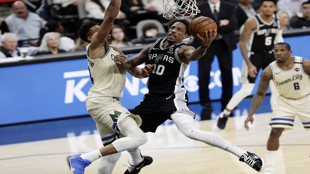 San Antonio Spurs guard DeMar DeRozan (10) scores against Milwaukee Bucks forward Thanasis Antetokounmpo, left, during the second half of an NBA basketball game in San Antonio, Monday, Jan. 6, 2020. (AP Photo/Eric Gay).