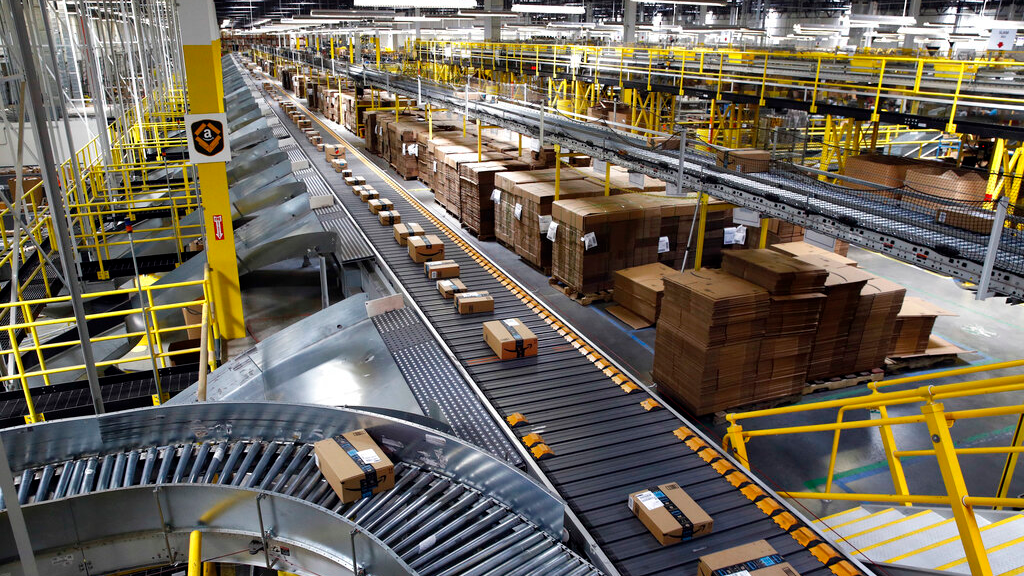 In this Aug. 3, 2017, file photo, packages ride on a conveyor system at an Amazon fulfillment center in Baltimore. (AP Photo/Patrick Semansky, File)
