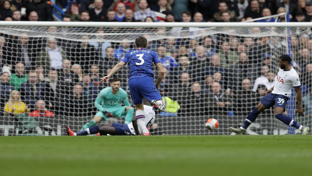 Chelsea's Marcos Alonso scores his team's second goal against Tottenham Hotspur during their English Premier League football match in London, England, Saturday, Feb. 22, 2020. (AP Photo/Kirsty Wigglesworth).