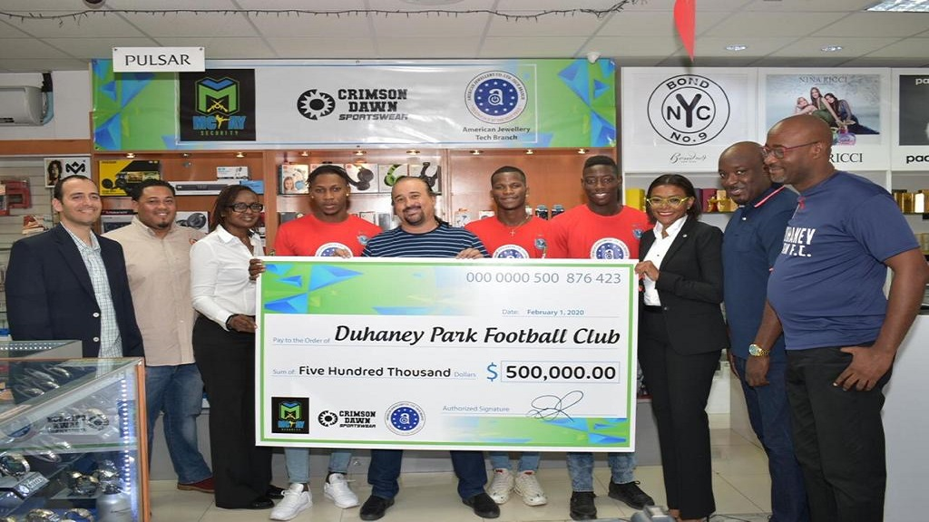 Sponsors' representatives and members of the Duhaney Park Football Club take part in a presentation ceremony at American Jewellery's Tech Branch, Mall Plaza, on Constant Spring Road in Kingston on February 10, 2020.