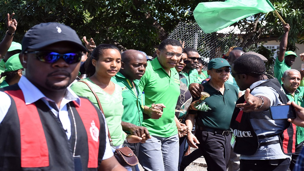 JLP candidate for South East Clarendon, Pearnel Charles Jr being supported by his wife and JLP bigwigs including Prime Minister Andrew Holness on nomination day. (Photo: Marlon Reid)