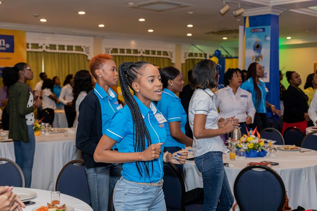 EduCom embers of staff in a cheerful mood during the praise and worship segment of the event.