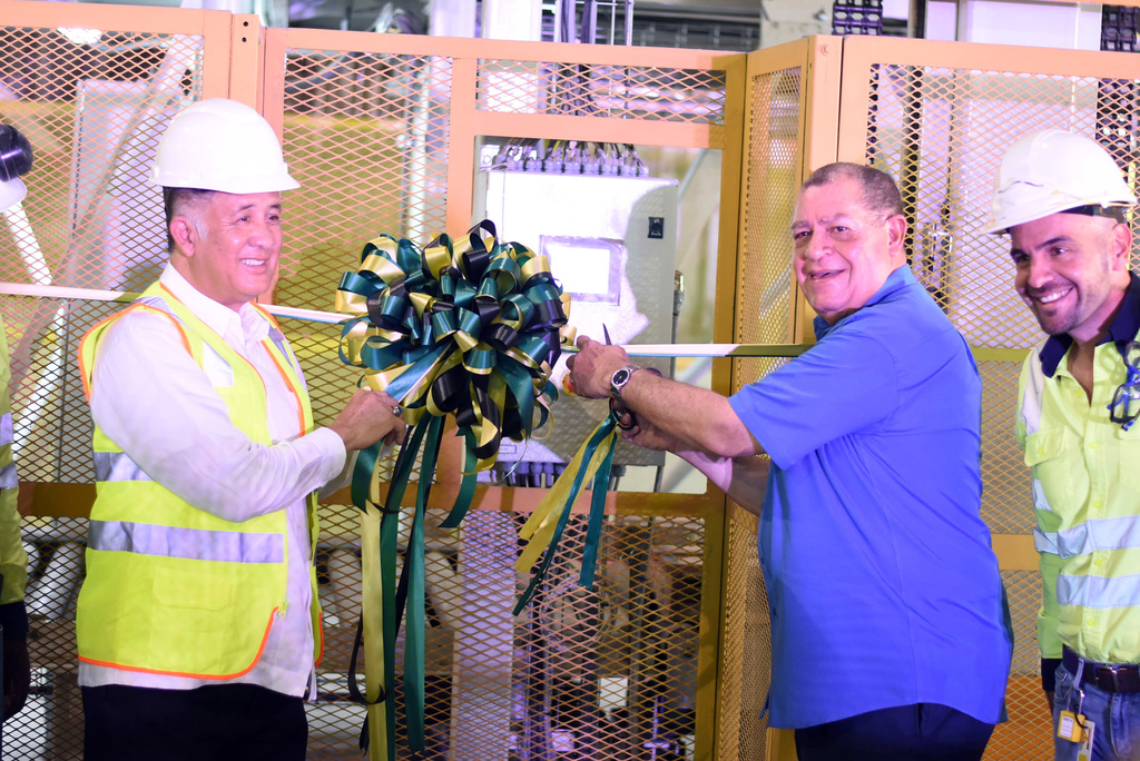 Industry Minister Audley Shaw (centre) joined Carib Cement chairman Parris Lyew-Ayee (left) and General Manager Yago Castro (right) at the commissioning of a new state-of-the-art stacking equipment on Monday. (Photo: Marlon Reid)
