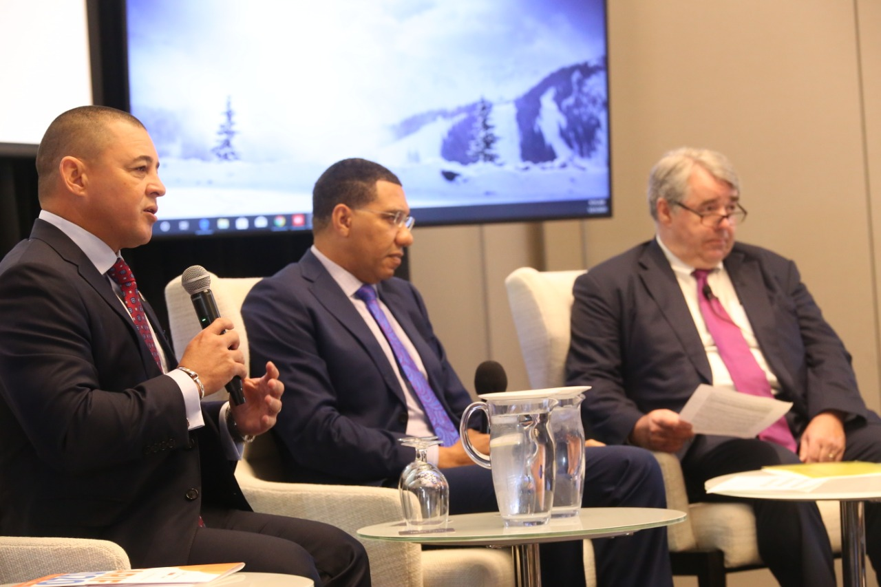 (Left to right) Infrastructure Minister, Hon. Joey Hew, the Most Hon. Andrew Holness, Prime Minster of Jamaica and Chairman Global Cities Center of Excellence, KPMG Canada, Steve Beatty during a panel discussion at the Caribbean Infrastructure Forum in Jamaica on January 21.