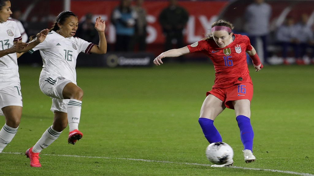 U.S. midfielder Rose Lavelle, right, scores past Mexico midfielder Karla Nieto during the first half of a Concacaf Women's Olympic qualifying football match Friday, Feb. 7, 2020, in Carson, Calif. (AP Photo/Chris Carlson).